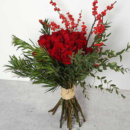 Red Roses and Ilex Berries Bouquet BH: Gift Delivery Bahrain