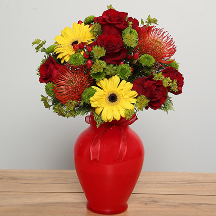 Mixed Flowers Arrangement In Red Glass Vase: Christmas Gift Ideas