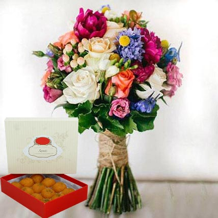 Mesmerizing Flowers and Motichoor Laddoo Combo: Eid Flowers & Sweets