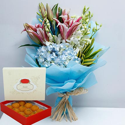 Pretty Flowers Bunch and Motichoor Laddoo Combo: Dubai Sweets