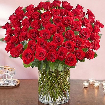 Ravishing 100 Red Roses In Glass Vase: