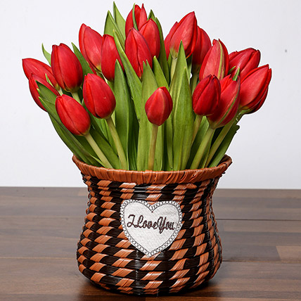 Blissful Red Tulips Basket: Wedding Anniversary Flowers