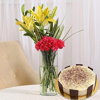 Happy Flower Arrangement & Tiramisu Cake: Saudi Arabia Gift Delivery