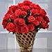 Red Roses In Cane Vase